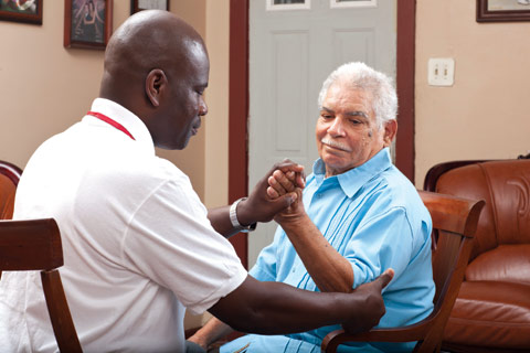 bayada client working with his physical therapist yomi
