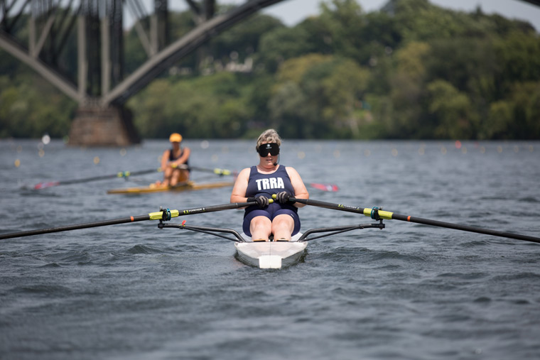 blind female rower on the river