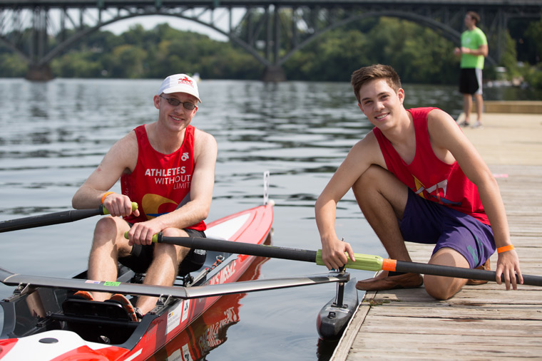 two rowers in athletes without limits tanktops