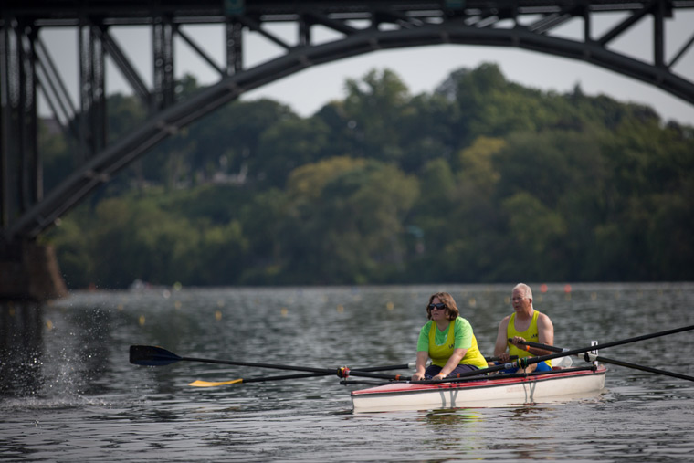 rowers racing under one of the bridges on the river