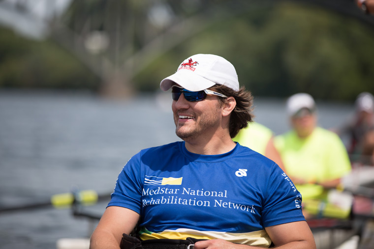 a close-up shot of a smiling rower